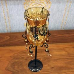 Подсвечник золотистый бокал