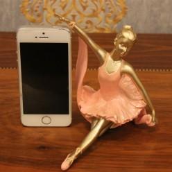 Балерина сидящая