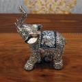 Слон маленький с хоботом наверх